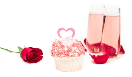cupcake isolated on a white background decorated with pink chocolate and a pink heart photo