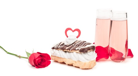 isolated chocolate eclair on a white background decorated with a valentines day heart photo