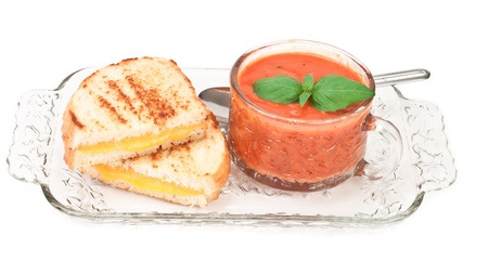 grilled cheese and tomato soup decorated with fresh basil photo