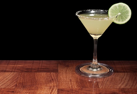 margarita served up on a bar top isolated on a black background Stock Photo