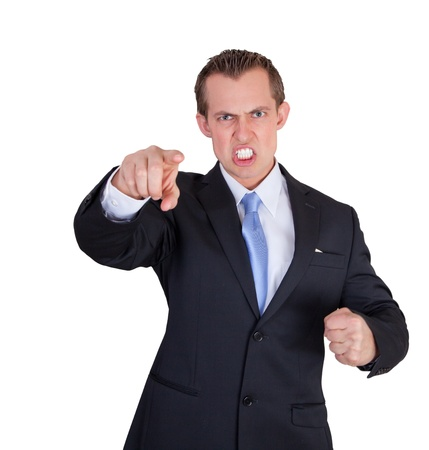 underpaid: angry business man pointing and making a fist Stock Photo