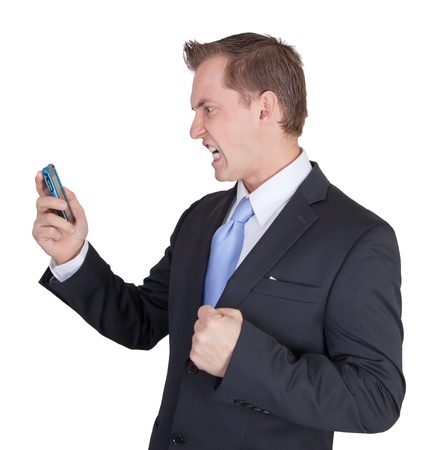underpaid: enraged business man yelling at the phone with and angry expression