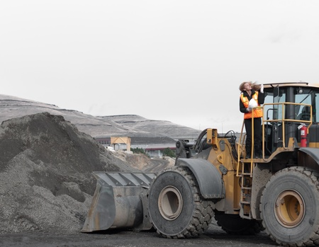 female construction worker with a front loader machine Stock Photo - 12228466