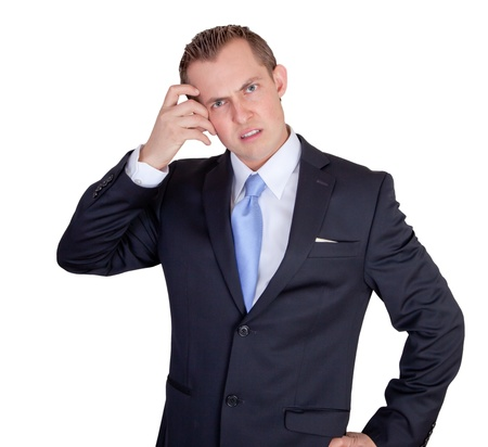 angry boss: Business man confused dressed in a suit scratching his head Stock Photo