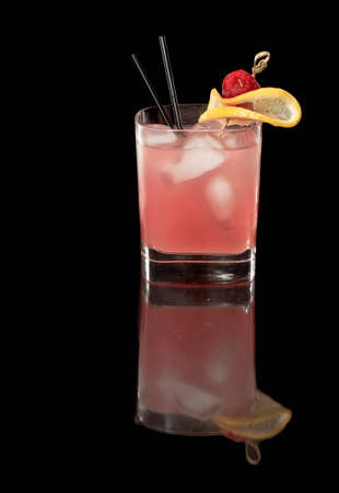 pink raspberry lemonade isolated on a black background garnished with lemon and red reaspberry with full reflection Stock Photo - 12499149