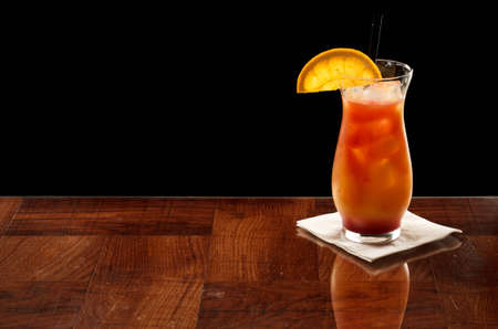 alcohol screwdriver: red and orange color drink on a bar top isolated on a black background Stock Photo