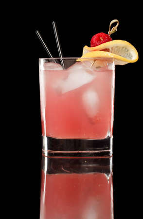 pink raspberry lemonade isolated on a black background garnished with lemon and red reaspberry Stock Photo - 12499291