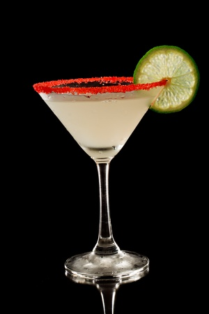key lime martini with a red sugar rim isolate don a black background Stock Photo - 12499414