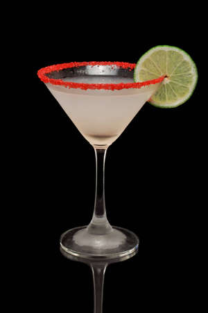 key lime martini with a red sugar rim isolate don a black background Stock Photo - 12499387