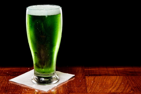St patricks day green beer isolated on a black background