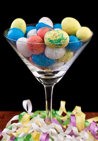 easter eggs in a martini glass isolated on black decorated with color ribbons Stock Photo - 12751932