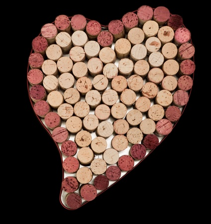 Stack of wine corks as a flat textured heart shaped background
