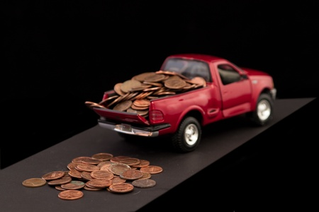 dirty car: truck load of pennies isolate don a black background Stock Photo