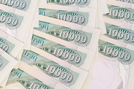 close up of ten thousand iraqi dinar notes photo