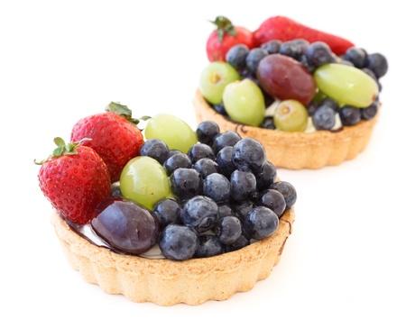 Fresh fruit tart isolated on a white background photo