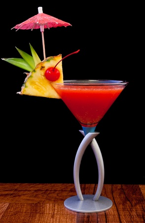 tropical cocktail isolated on a black background served on a bar top Stock Photo