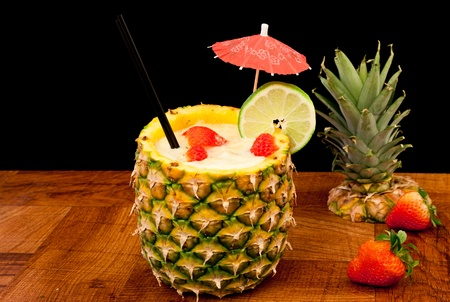 fresh tropical pina colada cocktail served in a pineapple