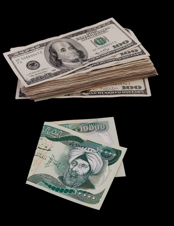 ten thousand Iraqui dinar bill and a bunch of hundred dollar bills isolated on a black background Stock Photo - 13030773