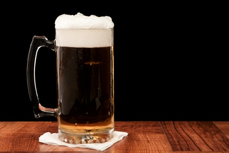 light pilsner served in a frosted mug isolated on a black backgound Stock Photo - 13030774