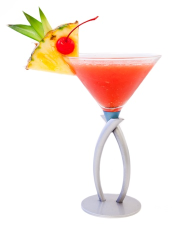 tropical cocktail isolated on a white background with pretty garnish photo