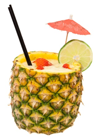 pina: fresh tropical pina colada cocktail served in a pineapple