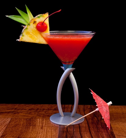 tropical cocktail isolated on a black background served on a bar top Stock Photo - 13030795