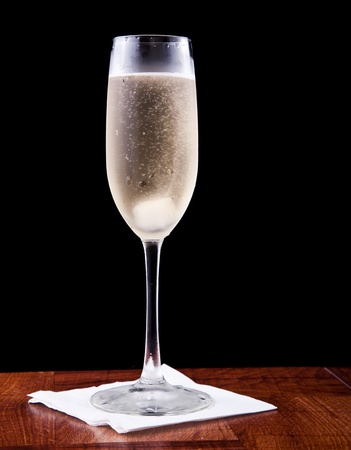champagne flute served with sprakling wine and a sugar cube isolated on a black background Stock Photo - 13233090