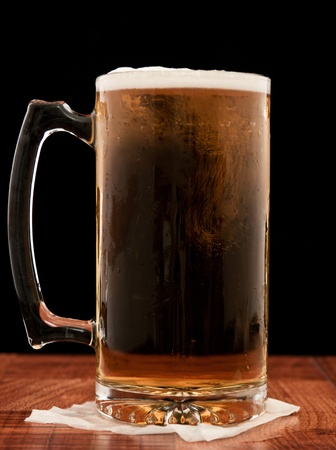 black backgound: light pilsner served in a frosted mug isolated on a black backgound Stock Photo