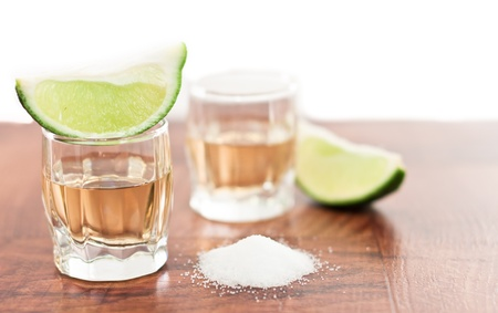 bar top with shot glass garnish with limeand salt photo