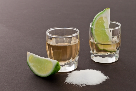 bar top with shot glass garnish with limeand salt