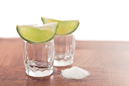 bar top with shot glass garnish with limeand salt Stock Photo - 13573271