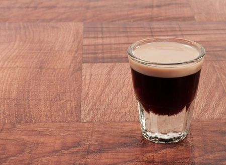 little beer shot on a bar top with coffee liquor and irish cream