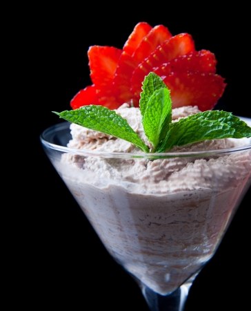 strawberries and chocolate mousse in a chilled martini glass with fresh mint garnish photo