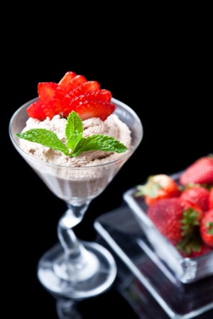strawberries and chocolate mousse in a chilled martini glass with fresh mint garnish Stock Photo - 13777461