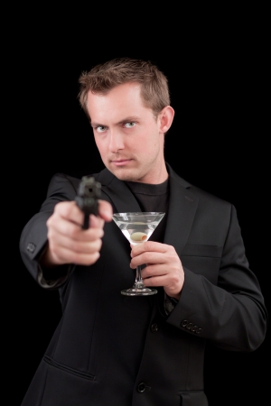 caucasian male model holding a gun isolated on a black background Stock Photo - 13991361