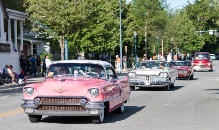 Coeur d' Alene, ID - June 15, 2012 : Parade of classic cars and trucs participating in the Car d' Alene car show in down town Coeur d' Alene ID