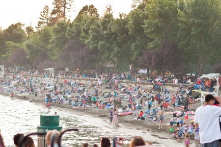 crowded beach in Coeur d Alene lake, hundreds of people waiting for the fireworks on july 4, Coeur d