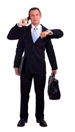 jonge man in een pak met vier armen geïsoleerd op een witte achtergrond lachende en multitasking