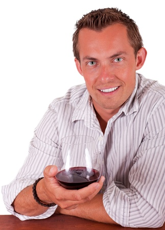 young man isolated on a white backgroung smiling and drinking wine
