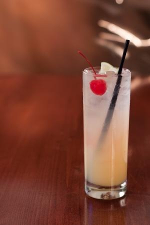 tom collins: Tom collins or vodka collins served on a bar top