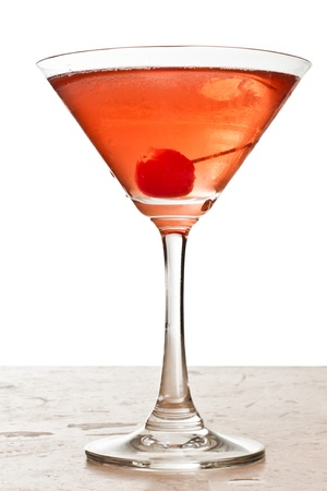 closeup of a manhattan cocktail isolated on a white background garnished with a cherry Stock Photo