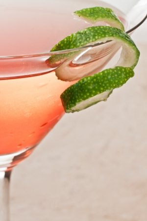 twist: closeup of a martini garnished with a fresh lime twist