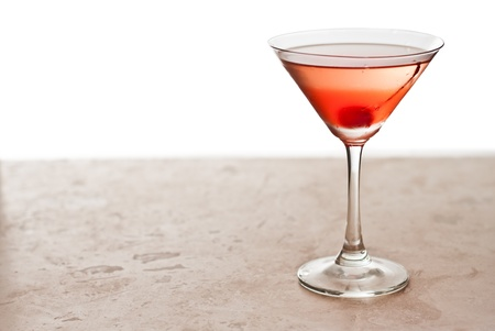 maraschino: closeup of a manhattan cocktail isolated on a white background garnished with a cherry Stock Photo