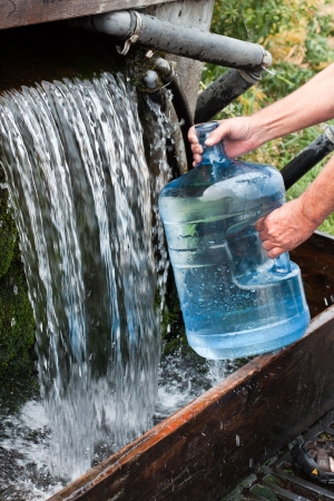 filling bottles with natural spring water in montana