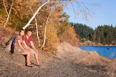 autumn in idaho, young couple sitting by the lake watching the sunset Stock Photo - 15738807