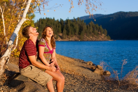 young couple laughing and having a good time by the lake Stock Photo - 15738792