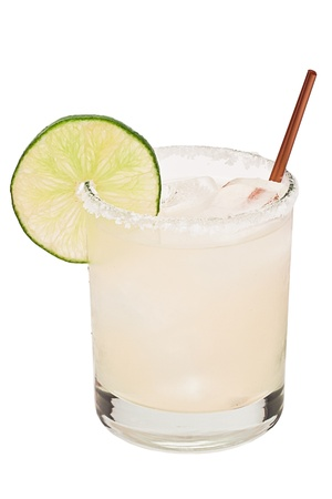 margarita on ice isolated on a white background garnished with a lime wheel photo