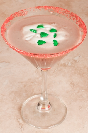 closeup of a holiday chocolate martini with a red sugar rim and sprinkles as a garnish Stock Photo - 16465367