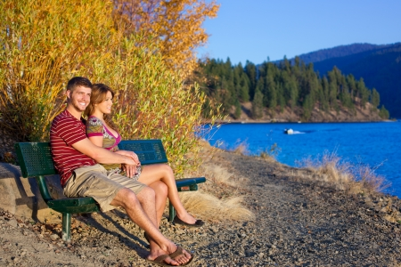 couple on a bench lake side with sunset view Stock Photo - 16488842