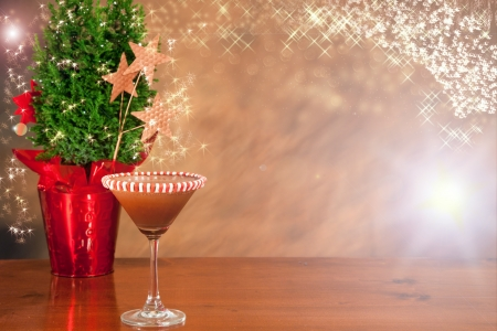 ocd: holiday background with sprkles and a small green tree with a decorated chocolate martini
